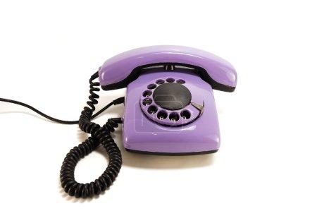 Photo pour Vieux téléphone Lilas isolé sur fond blanc - image libre de droit