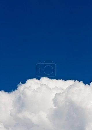 White clouds in the clear dark blue sky