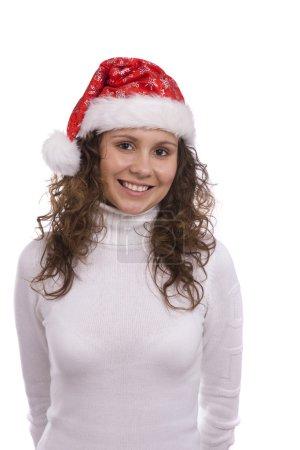Photo pour Santa girl dans le chapeau du Nouvel An. Femme habillée en bonnet de Noël rouge. Une bonne année ! - image libre de droit