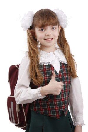 Smiling school girl. Education. OK sign.