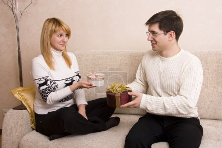 Man is giving gifts woman