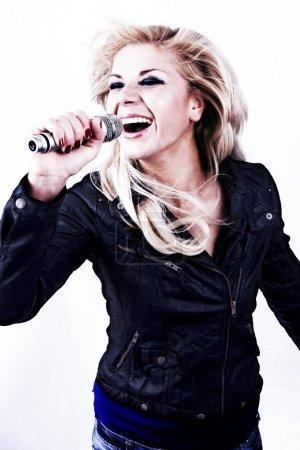 Rock singer.Girl singing into microphone