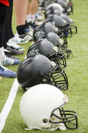 Row of football helmets