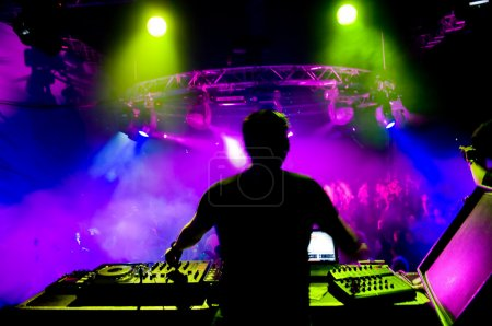 Photo for Dj at the concert, laser show and music - Royalty Free Image