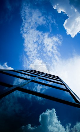 Skyscraper reflecting clouds