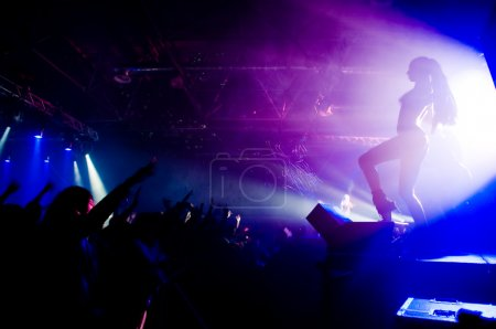 Photo for Relaxing at the concert, anonymous girl on the stage - Royalty Free Image