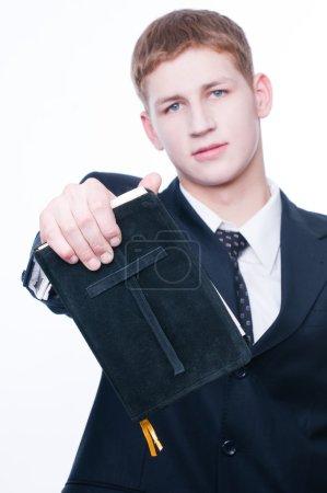 Young man showing Bible
