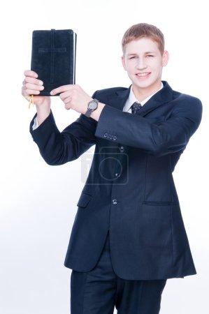 Cheerful man showing Bible