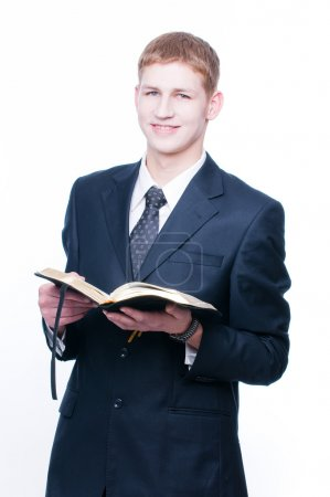 Cheerful man with Bible