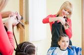 Pretty little girl in hairdresser salon