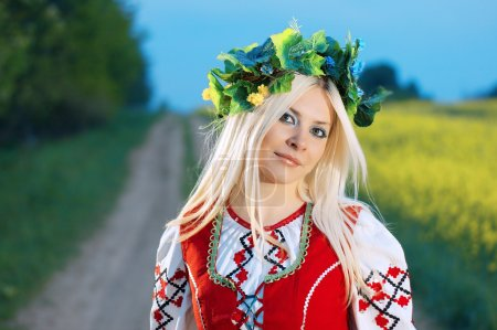 Photo for WOMAN IN A FOLK RUSSIAN DRESS - Royalty Free Image
