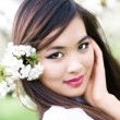 Young woman with cherry flowers. Shallow dof effec...