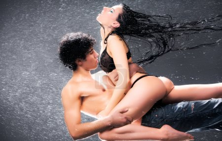 Photo for Young sexy couple. Water studio photo. - Royalty Free Image