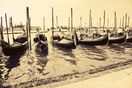 Gondolas at the wharf Venice Italy