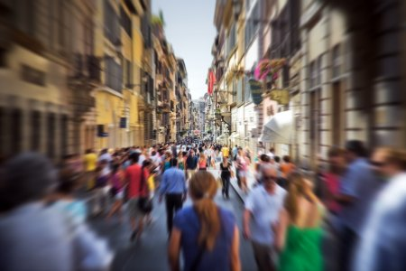 Photo for Crowd on a narrow Italian street. Motion blur effect. - Royalty Free Image