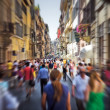 Crowd on a narrow Italian street. Motion blur effe...