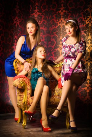 Photo for Three women in a luxury interior. Retro style. - Royalty Free Image