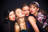 Four woman showing kiss sign