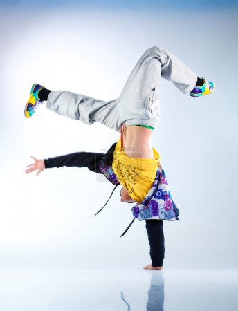 Photo for Young man modern dance. On soft white and blue background. - Royalty Free Image