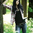 Young woman with guns in a forest....