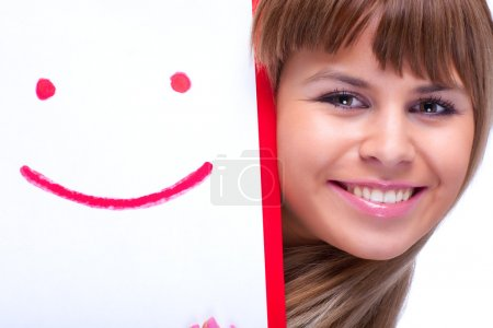 Young woman with smile symbol