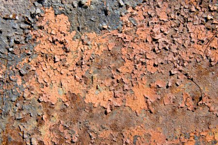 Rusty metal surface with cracky paint