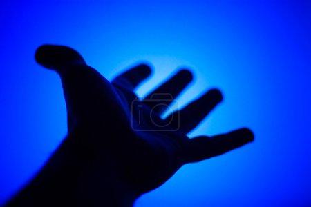 Hand facint to TV screen