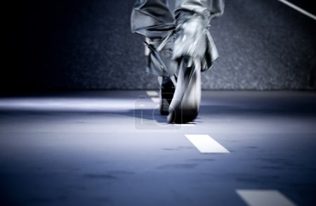Photo for Fashion show. Elegant step. Blue tint. - Royalty Free Image