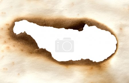 Burnt paper with hole