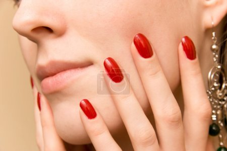 Elegant fingers on woman face