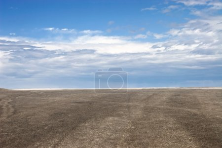 Photo for Blue sky and brown ground perspective view. - Royalty Free Image