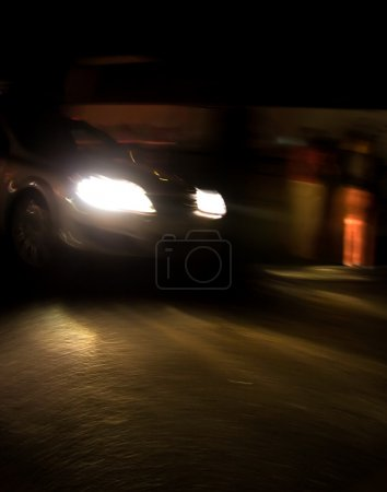 Fast moving car at night