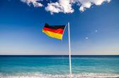 German flag on blue sky background