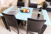 Modern kitchen table with fruits an wine