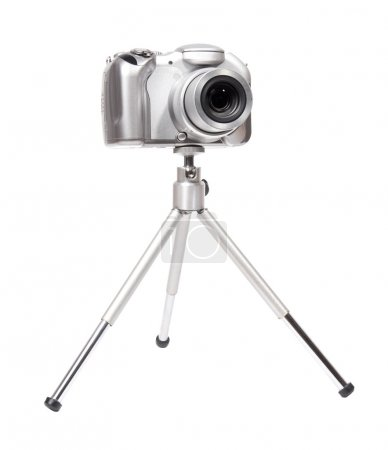Modern digital camera with tripod