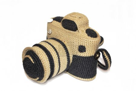 Knitted handmade photo camera over the white background