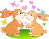Two cute rabbits in love on the spring meadow