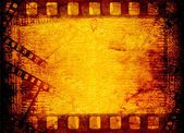 Old filmstrip on the paper background