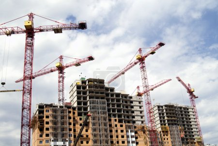Building cranes and building houses