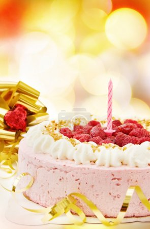 Photo for Celebrating a special day with delicious raspberry cake over defocused lights. - Royalty Free Image