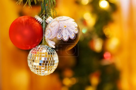 Photo for Celebrating magic night of Christmas with red, silver and mirrors baubles. Over defocused Christmas tree and fairy lights. - Royalty Free Image