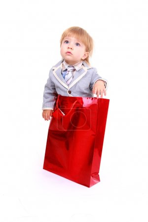 Photo for Portrait of cute boy on shopping bag isolated on white background - Royalty Free Image