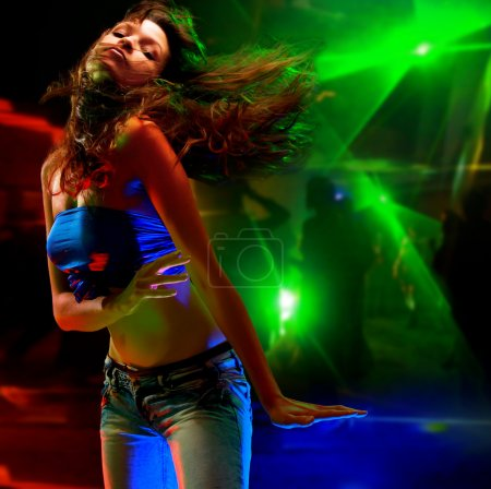 Photo for Beautiful young woman dancing in the nightclub - Royalty Free Image