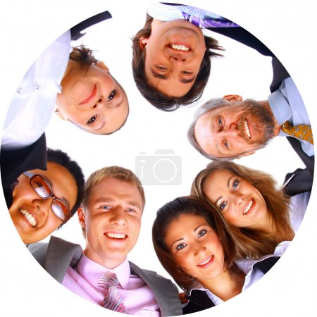 Photo for Group of business standing in huddle, smiling, low angle view - Royalty Free Image