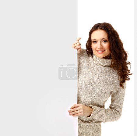 A beautiful woman holding a blank billbo