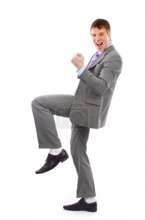 Photo for One very happy energetic businessman with his arms raised - Royalty Free Image