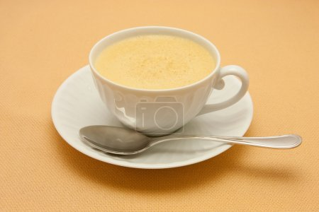 Closeup of coffee with milk in white cup
