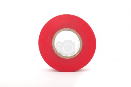 A roll of red insulating tape isolated on a white ...
