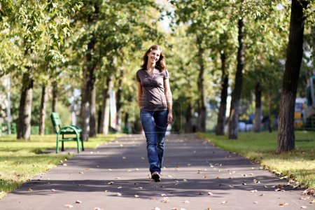 Walking woman in blue jeans