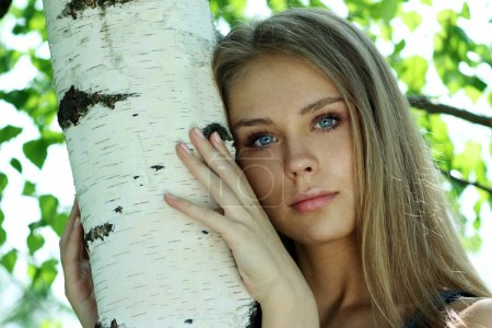 Photo for Portrait of the young beautiful girl on a background of leaves of a birch - Royalty Free Image